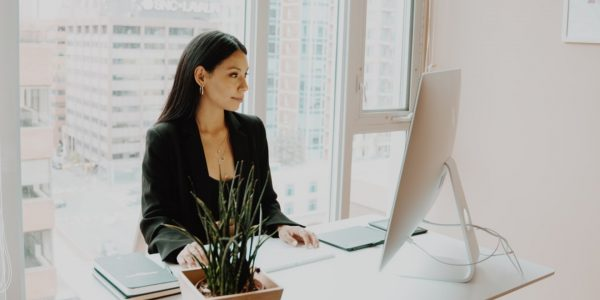 Woman working at her computer in an office