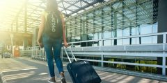 Young woman traveling to an airport
