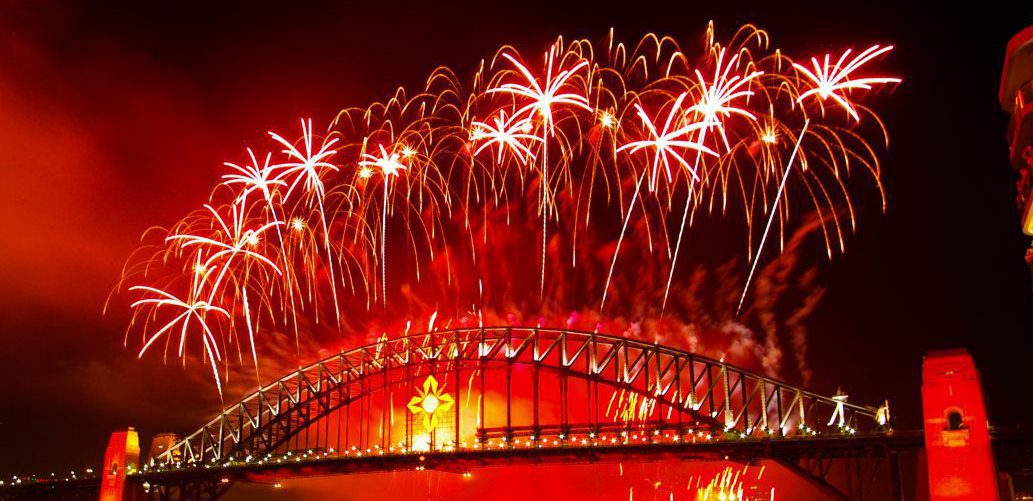 Crackling firework display above the Sydney bridge at New Year