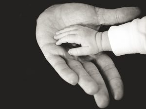 Picture of a child and an adults hand