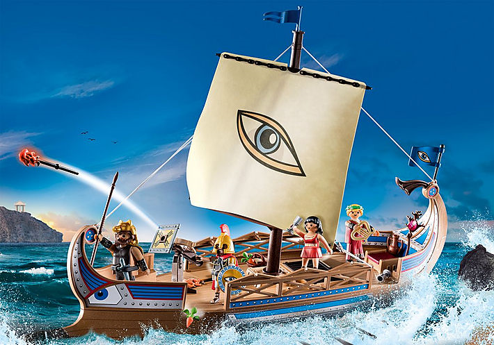 An image of a Playmobil ship on a painted backdrop. The ship has one central sail with a large eye painted on it.
