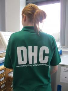 DHC Volunteer shirt modelled by student volunteer.