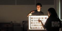 DHC volunteers examine slides using light-boxes.