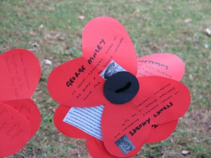 Inscribed paper poppy in Highfield Park, Life Lines final event, 5th August, 2014. Photo Charlotte Pratley.