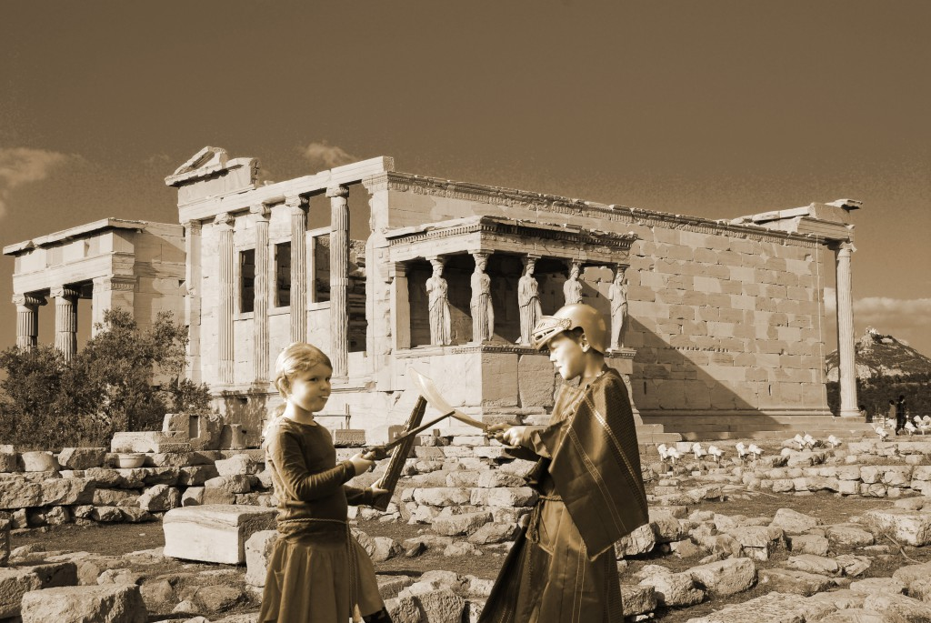 Young warriors battle it out in front of the Erechtheion, Athens, Greece.
