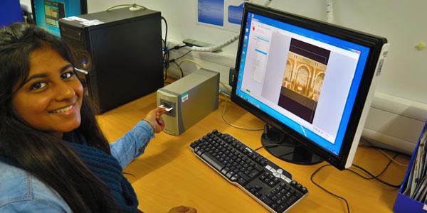 History undergraduate Depeeka Mistry using the Nikon Super CoolScan.