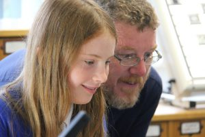 Image of DHC manager Matt Davies working with a student from Grassmoor Primary.