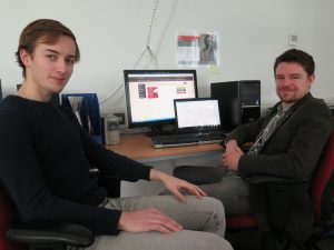 DHC Volunteers Jamie Shakespeare and Jack Strawbridge work on the ISYP database.