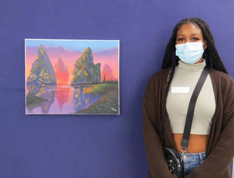 A photograph of Renee Gordon-Soanes and one of her works depicting Cuba's beauty