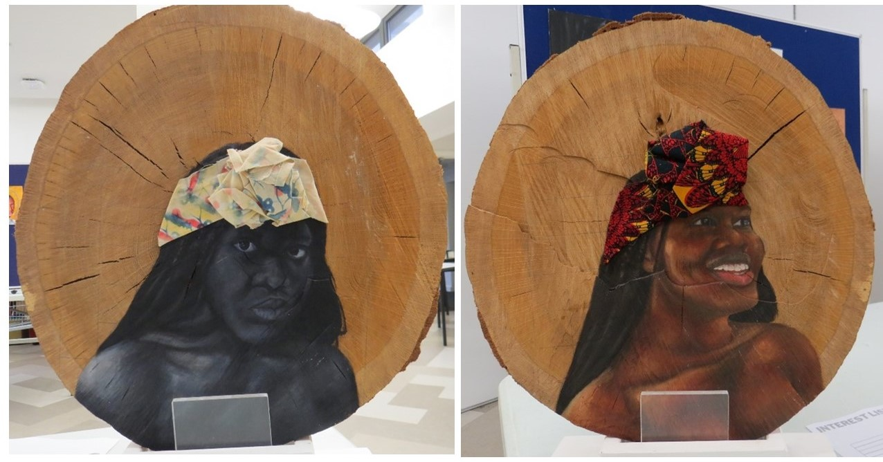 An example of Adagio Nkwocha's self-portraits; each on one side of the same section of wood