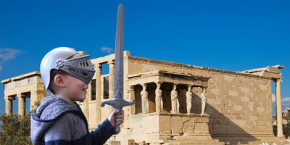 A young soldier stands guard outside the Erechtheion, Athens, Greece.
