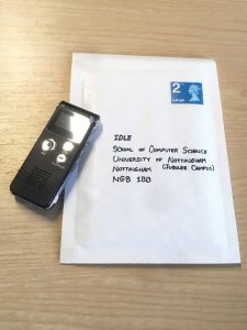 An envelope addressed to the research team and a recording device are pictured.
