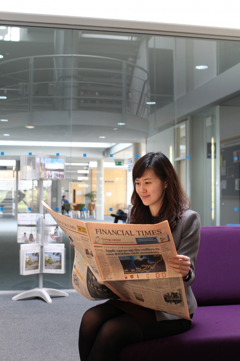 Female postgraduate student reading the Financial Times