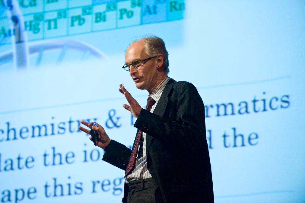 Photograph of David Salt in a suit, giving a speech