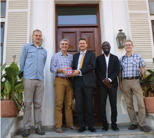 Five men standing in front of embassy in Senegal