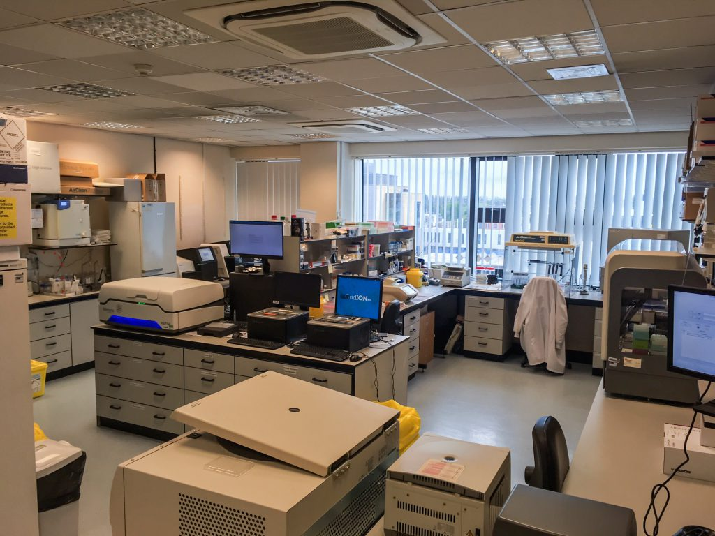 Photograph shows the genetics laboratory with sequencers on lab benches