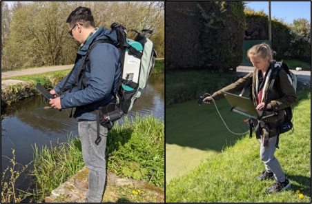 Researchers carrying ASD field spec and pointing it towards the water