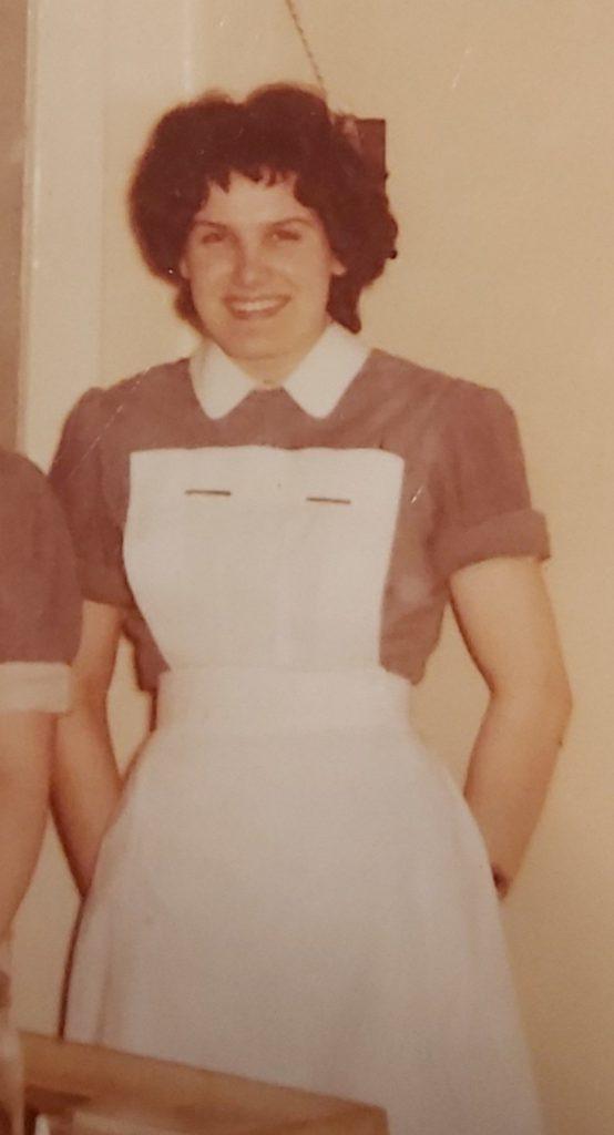 An old photo of Joan in her nurse's uniform
