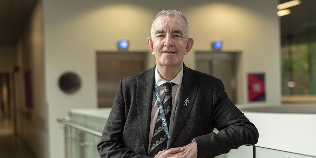 Professor Patrick Callaghan smiling at the camera