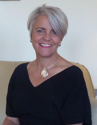 Dr Katharine Whittingham smiling at the camera