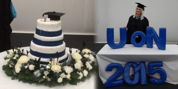 Graduation cake and Stephanie Manning standing behind the word UoN 2015
