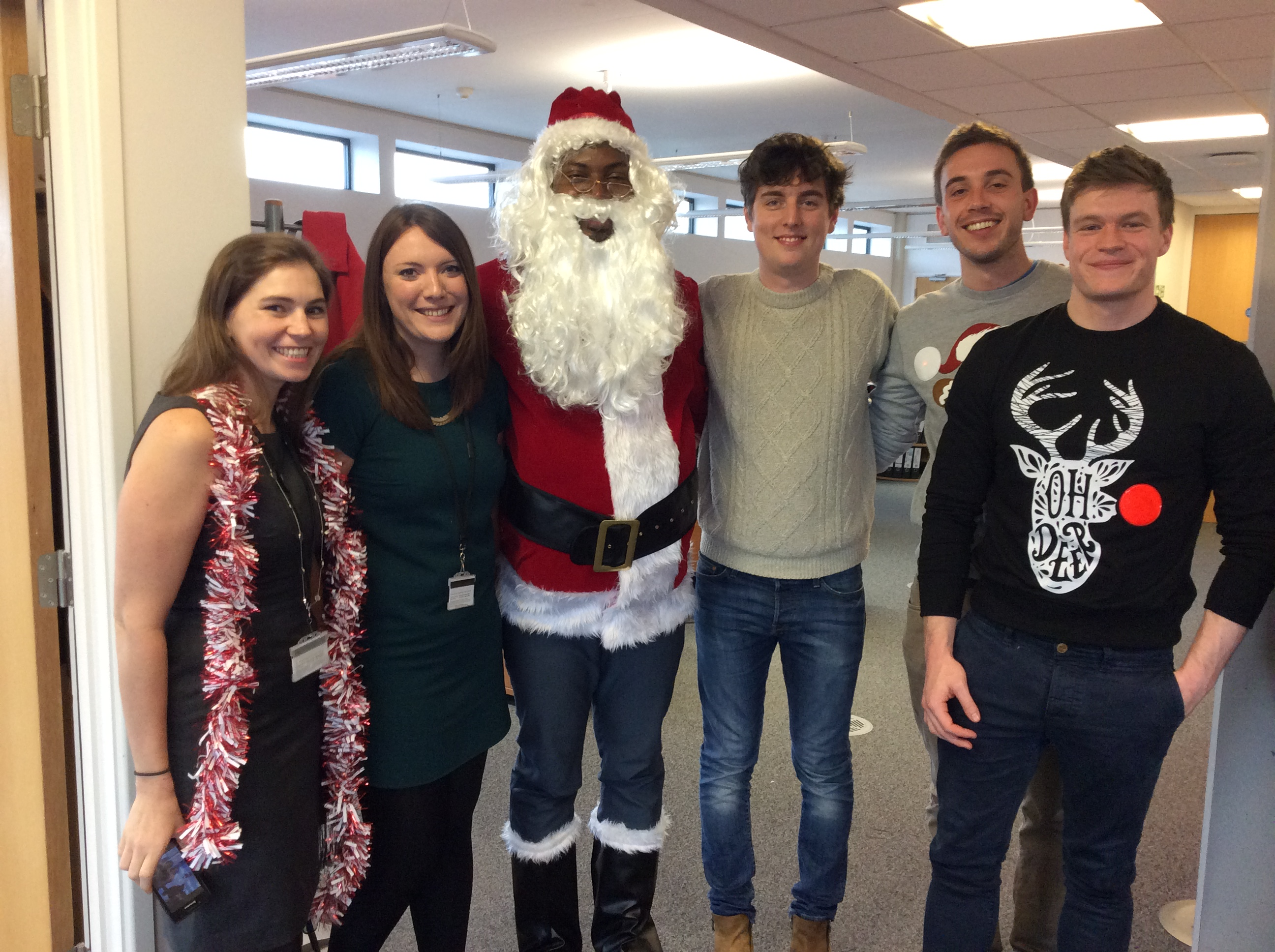 International Officers Emma, Hannah, Nduka (as Santa Claus), John, Luke and Tim