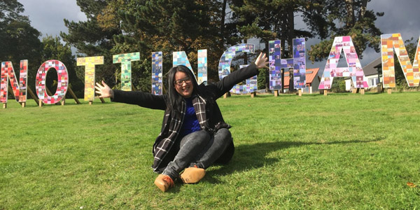 Wei in front of the Nottingham sign at our University Park Campus