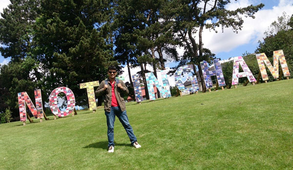 In front of Nottingham sign, University Park Campus