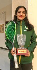 Faiza Zafar and a winner's trophy in squash