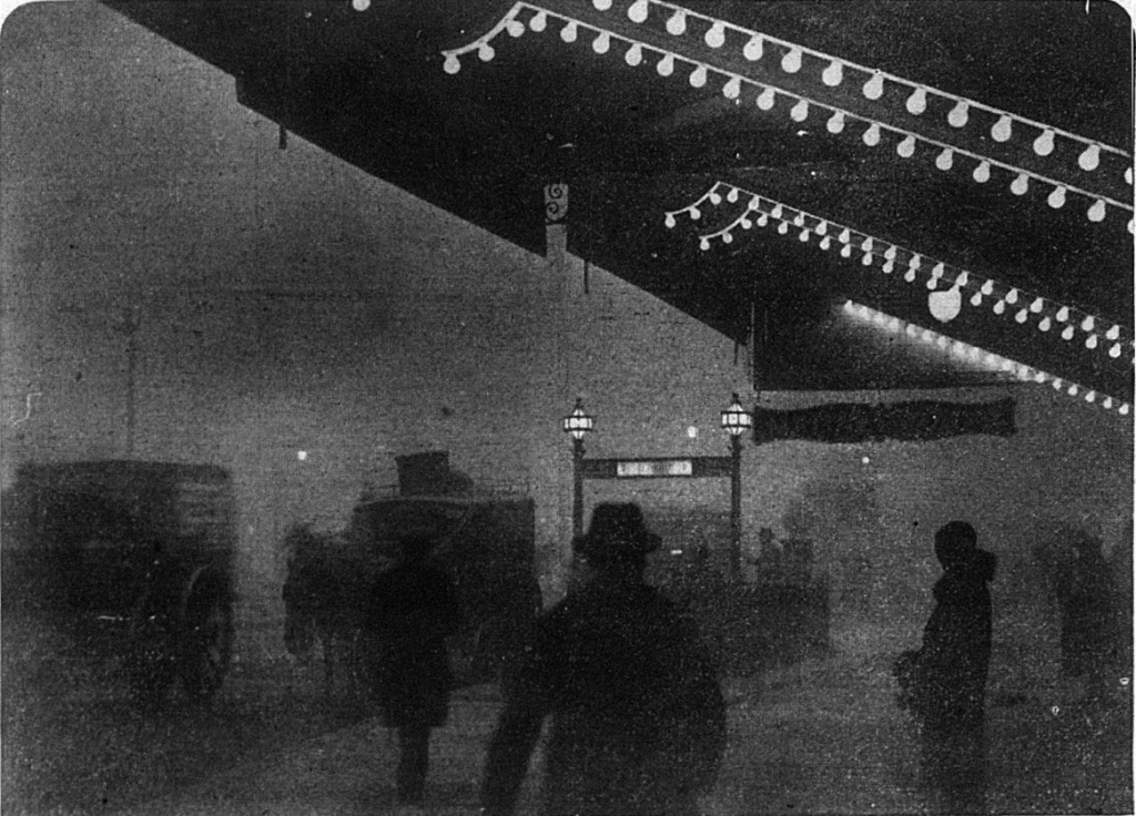 The lights of Piccadilly Circus shine through the thick fog that has brought night at noon