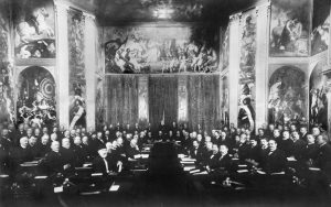 Delegates pose for a photograph in the opulent Orange Hall of Huis ten Bosch palace, with the intention of discussing world disarmament at the First Hague Conference.