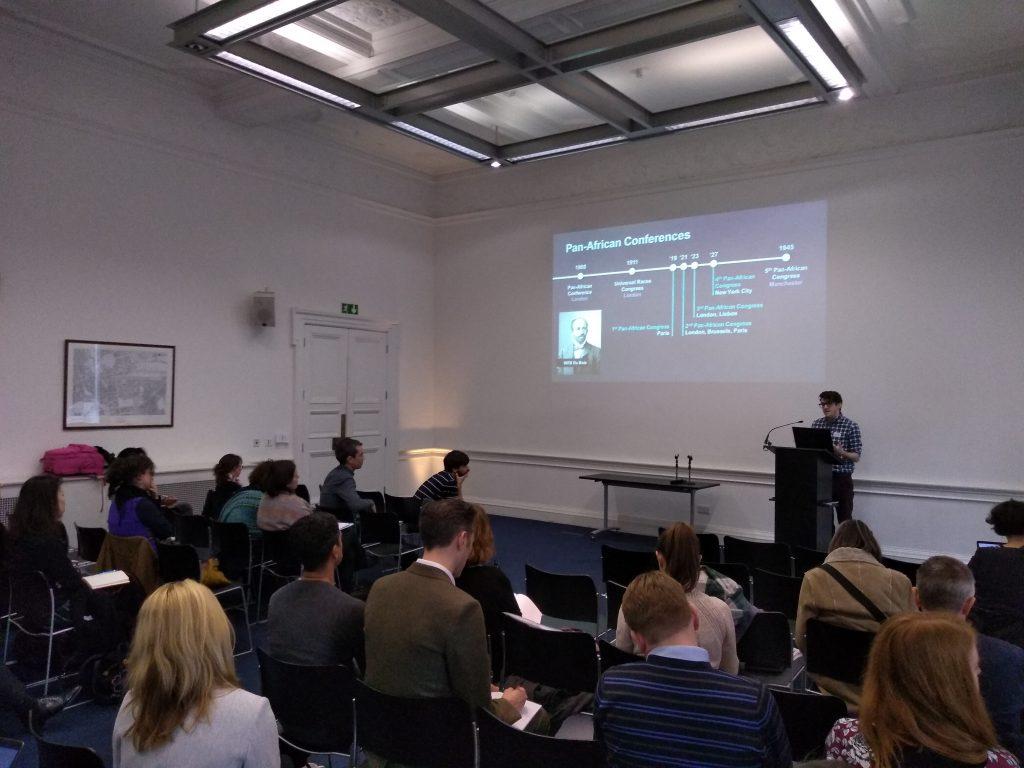Photograph of Jake Hodder presenting
