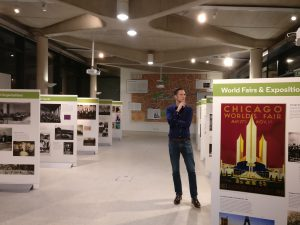 "Prof Stephen Legg stands contemplating the ""Spaces of Internationalism"" exhibition"