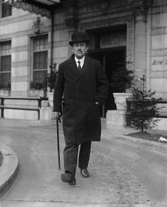 Photograph of Maurice Hankey strolling with his pipe, 1921