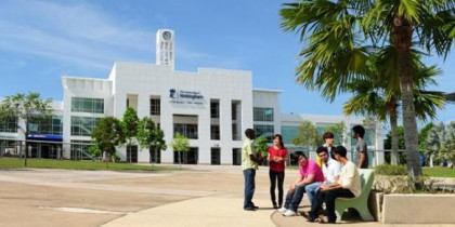 Group of undergraduate students sitting in front of administration building malaysia campus