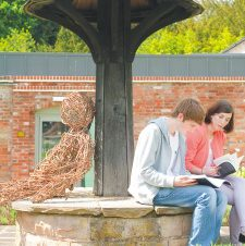 Students reading in the walled garden