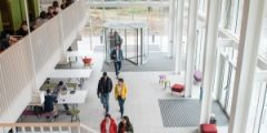 Students walking through the Teaching and Learning Building, University Park