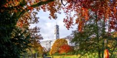 Trent Building framed by autumnal leaves, University Park