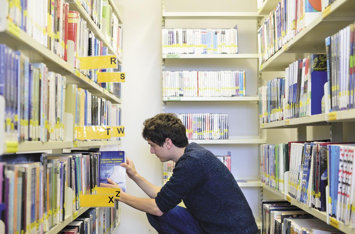 Student choosing book