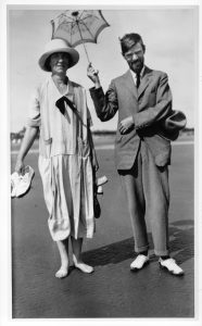 D.H. Lawrence and Ada Clarke (née Ada Lawrence) standing on the beach at Mablethorpe, Lincolnshire, August 1926; D.H. Lawrence is carrying a small parasol and his sister Ada is barefoot.