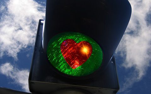 Green traffic light with heart