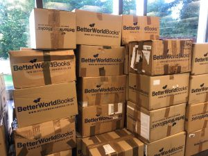 Boxes being packed to send to Better World Books