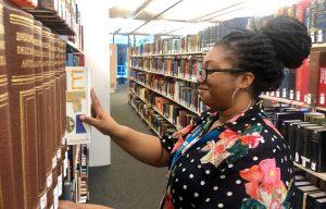 Library Advisor shelving books