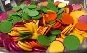 Multicoloured tokens in a bowl