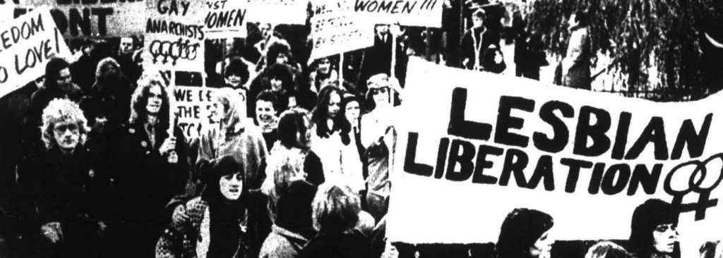 Black and white image of protesters holding banners which read Lesbian Liberation