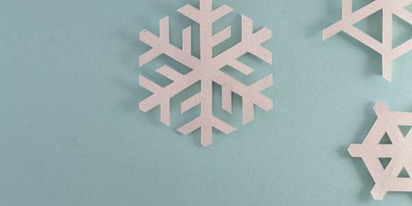 Paper snowflakes on a blue background