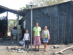 Doña Maria, her daughters and their solar panel.