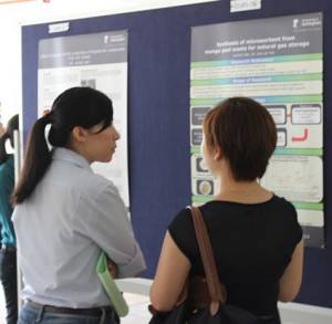 3rd prize winner, Miss Jecksin Ooi (right) presenting her poster to lecturer.