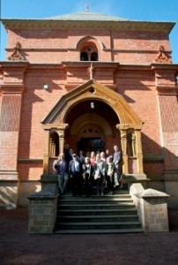 Group of people posing on the steps of Papplewick Pumping Station in the sunshine