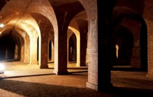 Dimply lit brick arches of the now-dry underground Reservoir